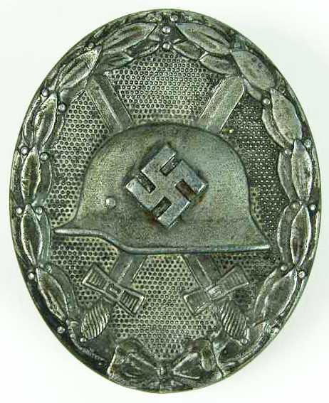 Distintivo de Herido en plata.
