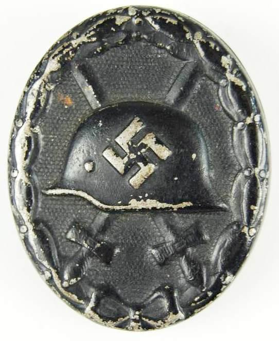 Distintivo de Herido en negro.